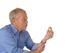 Senior man with golden egg poster