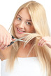 Woman cutting her hair with scissors