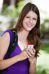 College girl holding cell phone