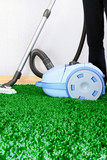 Vacuum cleaner in action  - a men cleaner a carpet.