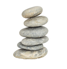 A stack of slightly off-balanced zen stones isolated on white ba