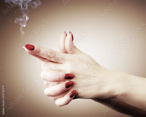 Women hands or gun with smoke, cimena concept
