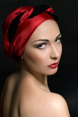 Fashion portrait of  woman in red turban