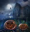 Pumpkins in graveyard with church ruins