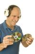 middle age senior man listening to music through classic head ph