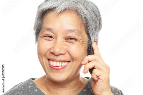 happy mature woman over cell phone