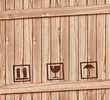 Safety fragile icon on wooden box with space