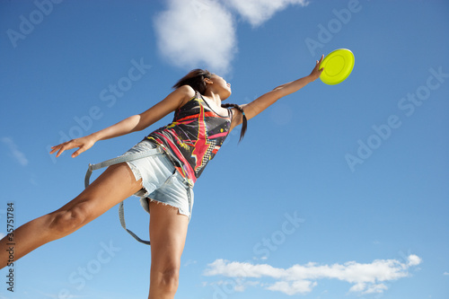 Teenage girl with frisbee