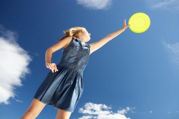 Teenage girl with frisbee