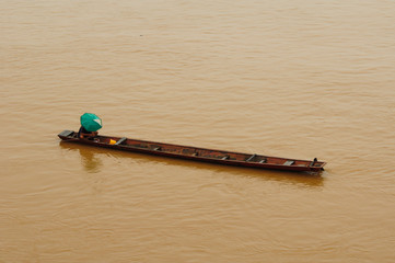 Fisherman in the boat at Mekong River