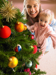 Mother and daughter with Christmas tree