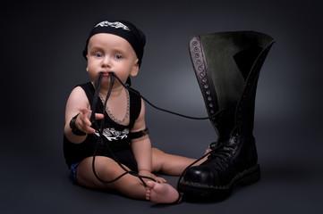 dark portrait of  rocker-baby on a black background