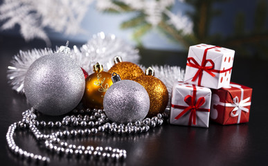 Christmas background with baubles and gift