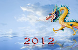 Golden dragon flying over the sea with 2010 year number