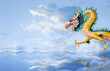 Golden dragon flying over the sea with nice sky background