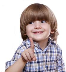 boy shows a finger