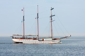 Typical old Dutch three mast clipper  sailing on the sea