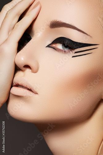 Fashion eyeliner makeup on model eyes. Sexy wild cat style