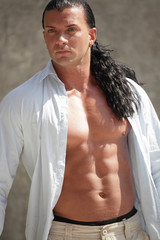 Image of a macho man with his shirt unbuttoned