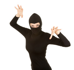 female thief in black clothes and balaclava, white background.