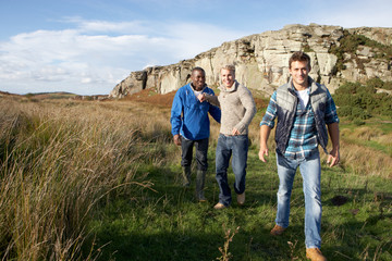 Young men on country walk