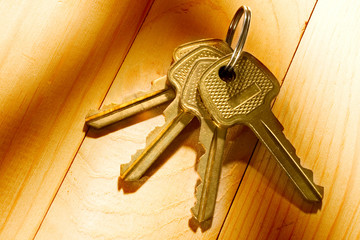 Bunch of keys isolated on the wooden background