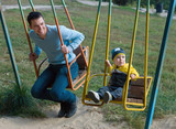Father and son on a swing