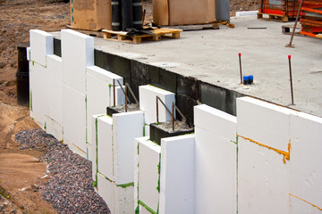 Insulating foundation wall in construction site