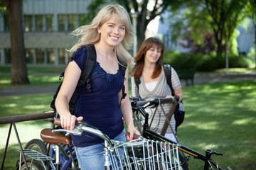 Female College Students with Bikes