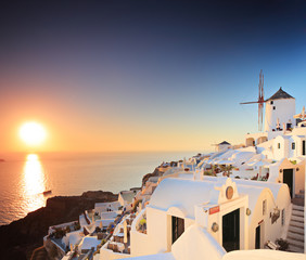 A view of a village on Santorini island and a sunset