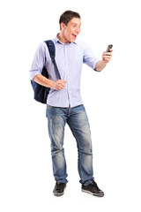 Smiling young man looking at a cell phone