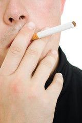 A man with a cigarette in his mouth.