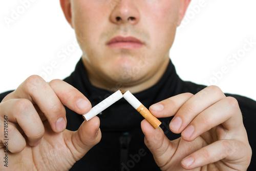 A man broke his cigarette.