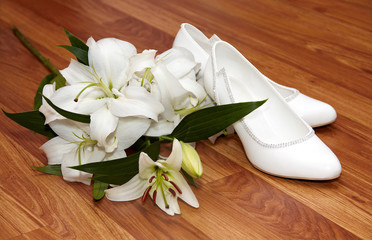 Wedding flowers and shoes on a floor