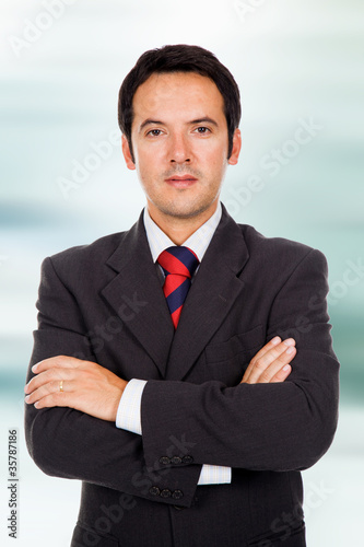 Close up portrait of an happy young business man