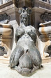 naked female statue gushing water