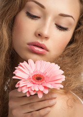 Beautiful woman with flower in her hand