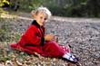Little blonde girl red coat