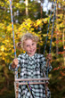 Autumn girl on a swing