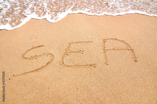 Sea you text written on the beach sand
