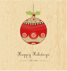 happy holidays; Christmas  ball on wood texture