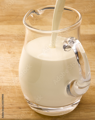 Milk jug on wooden table