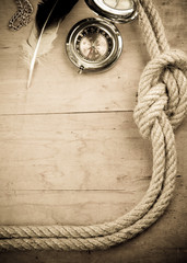 ship ropes and compass on woo