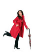 Woman in a red mac with an umbrella