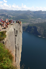 Preikestolen rock cliff at fjord with tourists