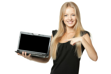 Pretty business woman pointing at laptop screen