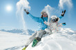 Winter fun - happy skiers playing in snow