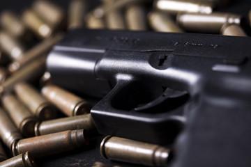 Ammunition and automatic handgun