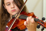 Young girl with violin focused on hand - 35806724