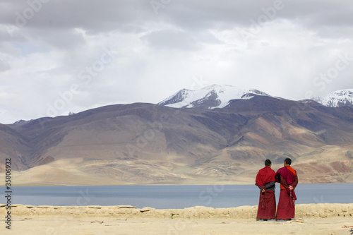 monks look tsomoriri lake Ladakh India